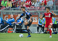 27 August 2011: San Jose Earthquakes forward Chris Wondolowski #8 and Toronto FC forward Peri Marosevic #70 in action during a game between the San Jose Earthquakes and Toronto FC at BMO Field in Toronto.