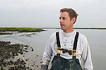 Oysterman, Jeff Spahr harvesting oysters on the Intracoastal Waterway, McClellanville, SC