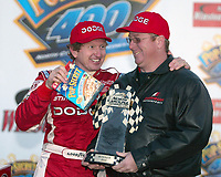 Bill Elliott (left ) offers crew chief Mike Ford a box of popcorn in victory lane after they won the Pop Secret 400 NASCAR Winston Cup race at Rockingham, NC on Sunday, November 9, 2003. (Photo by Brian Cleary)