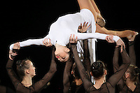 September 13, 2009; Mie, Japan;  Anna Bessonova of Ukraine is hoisted by team members primarily of the Ukrainian rhythmic group at the gala following the 2009 World Championships Mie, Japan. Photo by Tom Theobald.