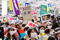 April 10, 2011, Tokyo, Japan - Carrying placards and banners reading Nukes, frustrated Tokyo residents make their feelings clear in anti-nuclear protests in Tokyo on Sunday, April 10, 2011. Some 15,000 people took to the streets in Tokyo in two separate protest against Tokyo Electric Power Company, the operator of the crippled nuclear plant in Fukushima, some 200 km northeast of Tokyo. (Photo by AFLO) [3609] -mis-