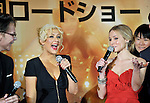 Singer and actress Christina Aguilera (2L) and actress Kristen Bell (3L) attend a red carpet event to promote their film Burlesque in Tokyo, Japan on Dec. 8 2010.