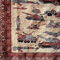 A rug with emblems of war.