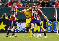 CD Chivas USA forward Justin Braun (17) battles with Columbus Crew's Shaun Francis (29). CD Chivas USA defeated the Columbus Crew 3-1 at Home Depot Center stadium in Carson, California on Saturday July 31, 2010.