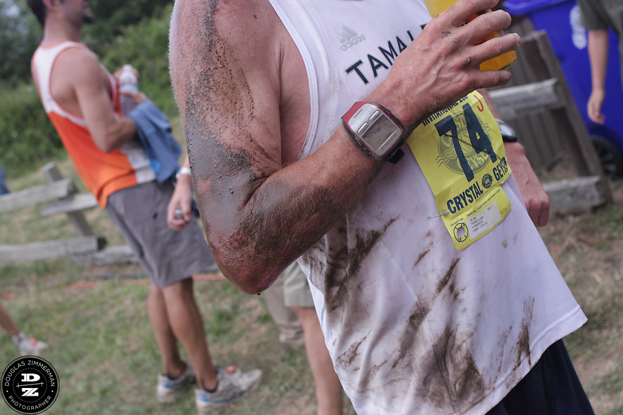 Ryan Matz (47) of Chico wears the mud he took from a spill while taking part in the 99th running of the Dipsea Race.  He was photographed after finishing the race at Sintson Beach State Park in Stinson Beach, Calif. on Sunday June 14th, 2009.