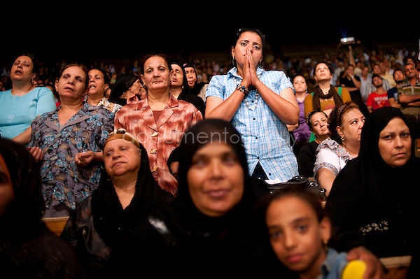 Copts and Muslims next to each others during the Thursday evening sermon in St Simeon Church until Father Samaan begins his exorcism.<br /> <br /> copyright : Magali Corouge / Documentography