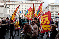 Protest, in front of Palazzo Chigi, seat of the government, more than 200 workers of the USB union, of the schools housekeeping to ask the assumption, against insecurity, they blocked the traffic in Corso street. Rome, Italy. 8th March 2016