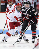 Evan Rodrigues (BU - 17), Colton Saucerman (NU - 23) - The visiting Northeastern University Huskies defeated the Boston University Terriers 6-5 on Friday, January 18, 2013, at Agganis Arena in Boston, Massachusetts.