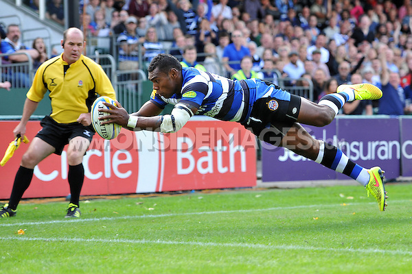 Semesa Rokoduguni dives for the try-line. Pre-season friendly match, between Bath Rugby and the Scarlets on August 16, 2014 at the Recreation Ground in Bath, England. Photo by: Patrick Khachfe / Onside Images