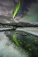 Northern lights reflect in the Koyukuk river, Brooks Range, Alaska.