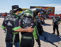Sep 4, 2016; Clermont, IN, USA; NHRA funny car driver Alexis DeJoria (right) walks with father John Paul DeJoria to her car during qualifying for the US Nationals at Lucas Oil Raceway. Mandatory Credit: Mark J. Rebilas-USA TODAY Sports