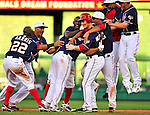 3 July 2010: Washington Nationals catcher Ivan Rodriguez is smothered by teammates  after hitting a game winning, walk-off RBI single in the bottom of the 9th against the New York Mets at Nationals Park in Washington, DC. The Nationals rally defeated the Mets 6-5 in the third game of their 4-game series. Mandatory Credit: Ed Wolfstein Photo