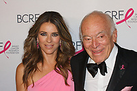 """Elizabeth Hurley and Leonard Lauder attend The Breast Cancer Research Foundation """"Super Nova"""" Hot Pink Party on May 12, 2017 at the Park Avenue Armory in New York City."""