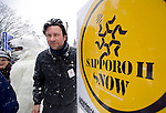 Kamiel Verschuren stands next to a sign advertising the Sapporo II Snow project during the Sapporo Snow Festival in Sapporo City, northern Japan on 05 Feb. 2010.