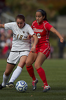 Boston College midfielder Patrice Vettori (18) and Marist College midfielder Samantha Panzner (16) battle for the ball. Boston College defeated Marist College, 6-1, in NCAA tournament play at Newton Campus Field, November 13, 2011.