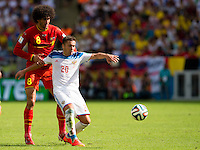 Marouane Fellaini of Belgium and Viktor Fayzulin of Russia