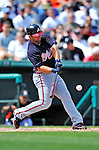 13 March 2012: Atlanta Braves infielder Dan Uggla singles during a Spring Training game against the Miami Marlins at Roger Dean Stadium in Jupiter, Florida. The two teams battled to a 2-2 tie playing 10 innings of Grapefruit League action. Mandatory Credit: Ed Wolfstein Photo