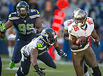 Tampa Bay Buccaneers running back Mike James runs away from Seattle Seahawks  linebacker Bruce Irvin (51) in the third quarter at CenturyLink Field in Seattle, Washington on  November 3, 2013.  The Seahawks beat the Buccaneers 27-24 in overtime.  ©2013. Jim Bryant. All Rights Reserved.