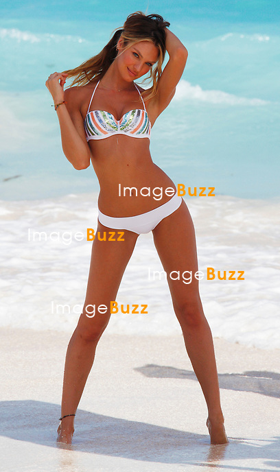 CANDICE SWANEPOEL - December 13,2012-Saint Barths (FR)- Victoria's Secret Angel Candice Swanepoel poses for the Victoriaís Secret bikini photoshoot in Saint Barths..