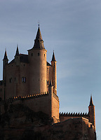 16th century Northern European style slate spires, The Alcazar, 12-16th centuries, Segovia, Castile and Leon, Spain. The current Alcazar was begun by King Alfonso VIII (1155-1214) and his wife Eleanor of England (1162-1214), and rebuilt 1258. Juan (John) II (1405-54) added the Gothic style Great Tower. Philip II (1527-98) modified the roofs with slate spires in Northern European style. The Alcazar was subsequently a state prison until it became the Royal Artillery School, 1762. It was damaged by fire, 1862 and restored, 1882, becoming a Military College, 1896. Picture by Manuel Cohen