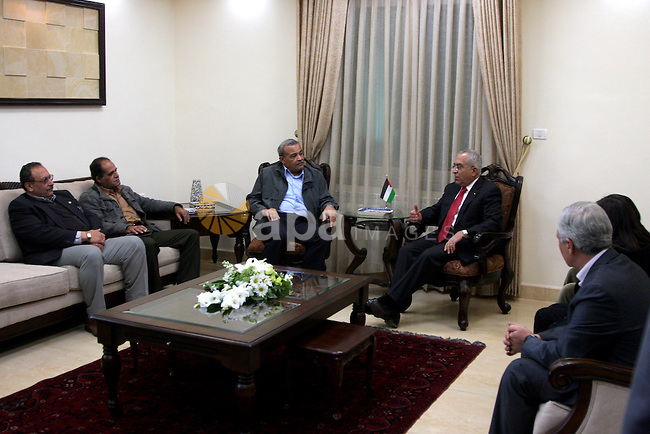Palestinian Prime Minister Salam Fayyad during his meeting with disabled delegation in his office in the West Bank city of Ramallah on Dec 23, 2009. Photo by Issam Rimawi