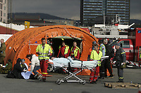 Disaster exercise in Oslo, with a scenario of a chemical tanker colliding with a bus. Civil defense units with ambulance crews.
