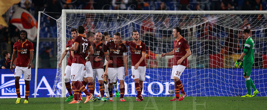 Calcio, Serie A: Roma vs Udinese. Roma, stadio Olimpico, 17 marzo 2014.<br /> AS Roma forward Francesco Totti, fourth from right, celebrates with teammates after scoring during the Italian Serie A football match between AS Roma and Udinese at Rome's Olympic stadium, 17 March 2014.<br /> UPDATE IMAGES PRESS/Isabella Bonotto