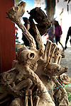 Dried llama fetuses are stacked and strung together at the Witches Market in La Paz.  The fetuses are bought by Bolivians and buried under the foundation of their homes for good luck and as an offering to Pachamama, the Aymaran/Incan goddess of Mother Earth.