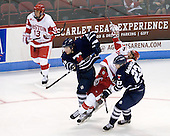 Garrett Noonan (BU - 13), Dan Brewer (Toronto - 19), ? Charlie McDonald (Toronto - 23) - The Boston University Terriers defeated the visiting University of Toronto Varsity Blues 9-3 on Saturday, October 2, 2010, at Agganis Arena in Boston, MA.