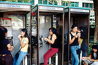 Singapore. Downtown. Town center. Orchard Road is mostly a place to shop with rows of modern shopping centres and the location for most international hotels. Philippino women meet usually on sunday afternoon on their day off in a small park on Orchard road and use the public phone box to call their families which are left at home in the Philippines. © 2001 Didier Ruef