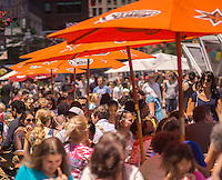 Lines at the food vendors in the South Street Seaport outpost of Smorgasburg in New York on Friday, July 3, 2015. The popular hipster eatery has opened satellites in a number of places such as the South Street Seaport and Coney Island.  (© Richard B. Levine)