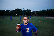 Nick Acosta enjoys a cold beverage prior to pitching for Balls Deep during a kick ball match at Pullen Park in Raleigh, Tuesday, Aug. 12, 2008.