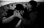 Sabet (r) is comforting his wife Sanaa, as they lost their 18 yr old son in a horrific motorbike accident in Cairo.<br />