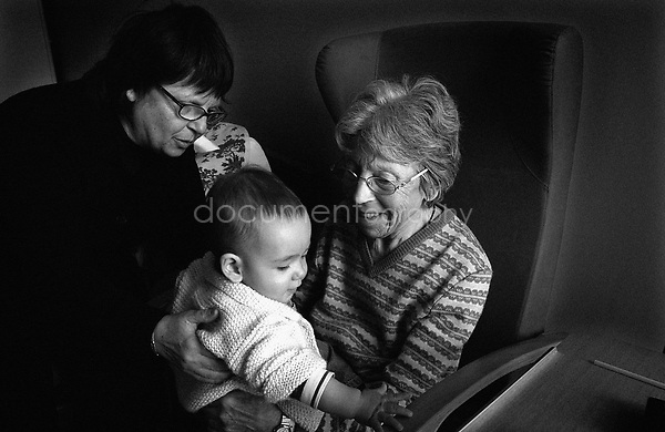 "It is the first time that the ""little monster"" comes to visit my grandmother. He is my sister's first son and so my grandmother's grand children. When we come and visit her with him we never know if she will recognise all of us...© Magali Corouge/Documentography.2004-2006.France"