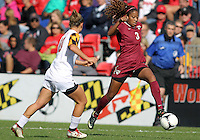 COLLEGE PARK, MD - OCTOBER 21, 2012:  Riley Barger (10) of the University of Maryland closes in on Casey Short (3) of Florida State during an ACC women's match at Ludwig Field in College Park, MD. on October 21. Florida won 1-0.