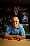 "Former Chicago Cardinals football player Charley Trippi was inducted into the College Football Hall of Fame and the Pro Football Hall of Fame during his career in the sport. ""I'll always be a Georgia fan,"" she said, ""Georgia's my home."" He poses in his Athens, Georgia home. KENDRICK BRINSON"