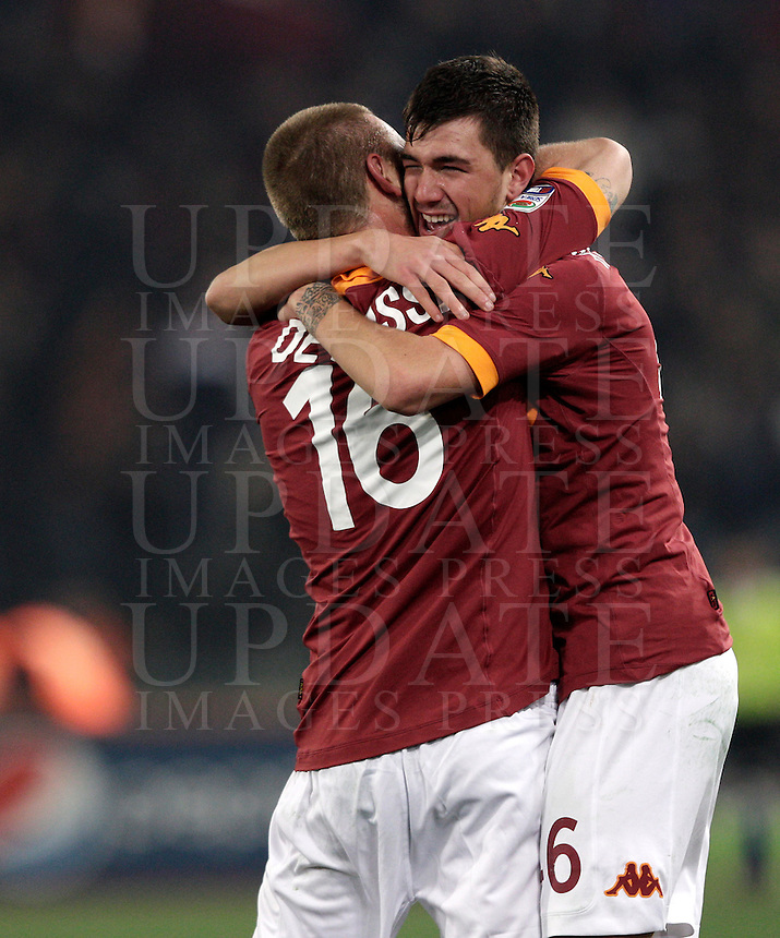 Calcio, Serie A: Roma vs Genoa. Roma, stadio Olimpico, 3 marzo 2013..AS Roma defender Alessio Romagnoli is hugged by teammate Daniele De Rossi, left, after scoring during the Italian Serie A football match between AS Roma and Genoa at Rome's Olympic stadium, 3 March 2013..UPDATE IMAGES PRESS/Riccardo De Luca