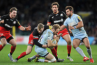 Chris Pennell of Worcester Warriors is tackled to ground by Chris Ashton of Saracens. Aviva Premiership match, between Saracens and Worcester Warriors on November 28, 2015 at Twickenham Stadium in London, England. Photo by: Patrick Khachfe / JMP