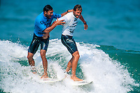 Sunny Garcia (HAW) and Jeff Booth (USA) during the running of the Gotcha Lacanau Pro at Lacanau Beach, in the South West of France. Circa 1995. Garcia after losing a close heat picked up a muffin and hurled it at the judges stand. The judges actually thought it was a rock and had ducked away from the glass front as it came towards them. Garcia was fined for his outburst. Photo: joliphotos.com