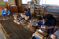 Metalwork artisan Hiroshi Kikuchi (left) with two of his staff, Iwayado, Oshu City, Iwate Prefecture, Japan, July 19, 2013. Iwayado Tansu chests of drawers have been made in the city of Oshu since the 1780s. They are noted for their fine lacquer finish and finely-wrought metalwork fittings.