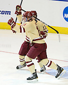 Pat Mullane (BC - 11), Johnny Gaudreau (BC - 13) - The Boston College Eagles defeated the University of Minnesota Duluth Bulldogs 4-0 to win the NCAA Northeast Regional on Sunday, March 25, 2012, at the DCU Center in Worcester, Massachusetts.