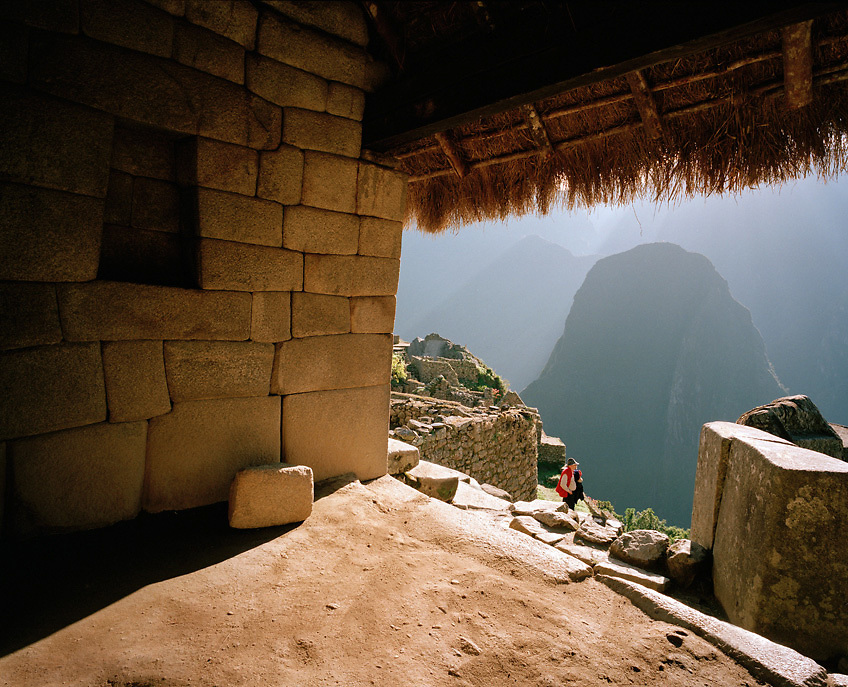 Peru, South America, southern hemisphere, Peruvian, Machu Picchu, hillside, Inca, Incan, Incan Empire, deities, mountaintop, architecture, Hiram Bingham, discovery, lost city, Urabamba, cloud forest, sun, sunlight, Inca trail, World Heritage Site, mountains, Andes, dawn, sunrise, ray of light, copy space, horizontal, terraces, architecture, peak, Picchu, mountainous, hiking, trekking, destination, traveler, trip, tourism, historic, temple, one person, one man, inside, interior, open, worship, hill, stonework, trapezoid, thatched roof, sunshine, light Machu Picchu, Peru