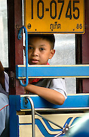 A young boy on his way to school in Phuket Town in south Thailand. Phuket is a great window into the life of real, everyday, modern Thais. The scene in downtown is quite and the streets of Old Phuket are lined with 19th century shop houses that now house restaurants, guesthouses, cyber cafés, coffee shops and the local business..