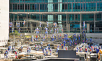 Dubai.  Scaffolders working on support for seating at a major event behind The Gate building at Dubai?s Financial Centre/center.