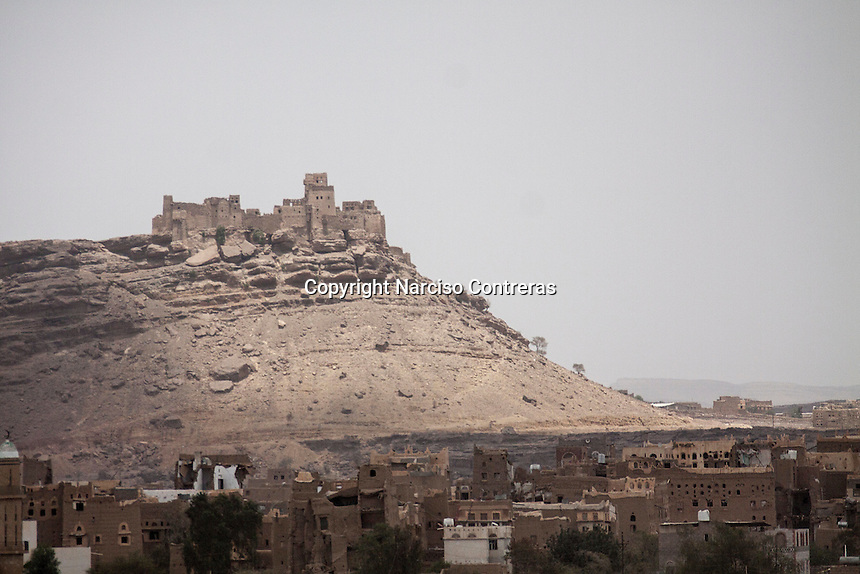 "Wednesday 15 July, 2015: A fortress is seen at the top a mountain in Dammaj valley in the northern province of Sa'dah, the stronghold of the Houthi's movement declared unilaterally ""a military zone"". The historic city of Sa'dah is among the places submitted on a tentative list to be under protection of UNESCO as a World Heritage site like the others enlisted cultural heritage sites in Yemen, such as the historic town of Zabid, the Old City of Sana'a and the Old Walled City of Shibam endangered by the ongoing aerial campaign of bombardments. (Photo/Narciso Contreras)"