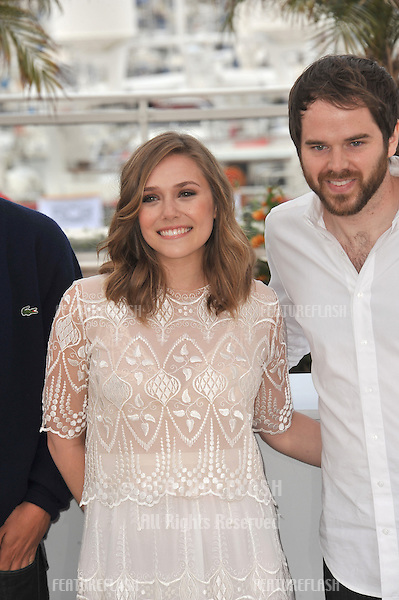 """Elizabeth Olsen & Sean Durkin at the photocall for their movie """"Martha Marcy May Marlene"""" at the 64th Festival de Cannes..May 15, 2011  Cannes, France.Picture: Paul Smith / Featureflash"""