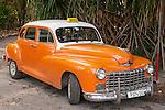 Finca La Vigia, San Francisco de Paula, Cuba; a classic orange colored 1946 Dodge parked near the Hemingway Museum
