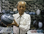 Company manager holds one of his company's blown glass vases at the Hokuyo Glass Manufacturing Company's  Blown Glass Factory in Aomori, Japan. Glass blowers at the factory churn out between 1,500 and 2,000 pieces of glass daily. (Jim Bryant Photo).....