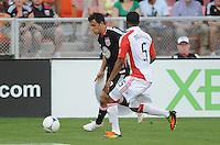 D.C. United midfielder Danny Cruz (2) goes against Toronto FC defender Ashtone Morgan (5) D.C. United defeated Toronto FC 3-1 at RFK Stadium, Saturday May 19, 2012.