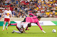 Houston Dynamo goalkeeper Tally Hall (1) dives over Thierry Henry (14) of the New York Red Bulls during a Major League Soccer (MLS) match at Red Bull Arena in Harrison, NJ, on August 10, 2012.